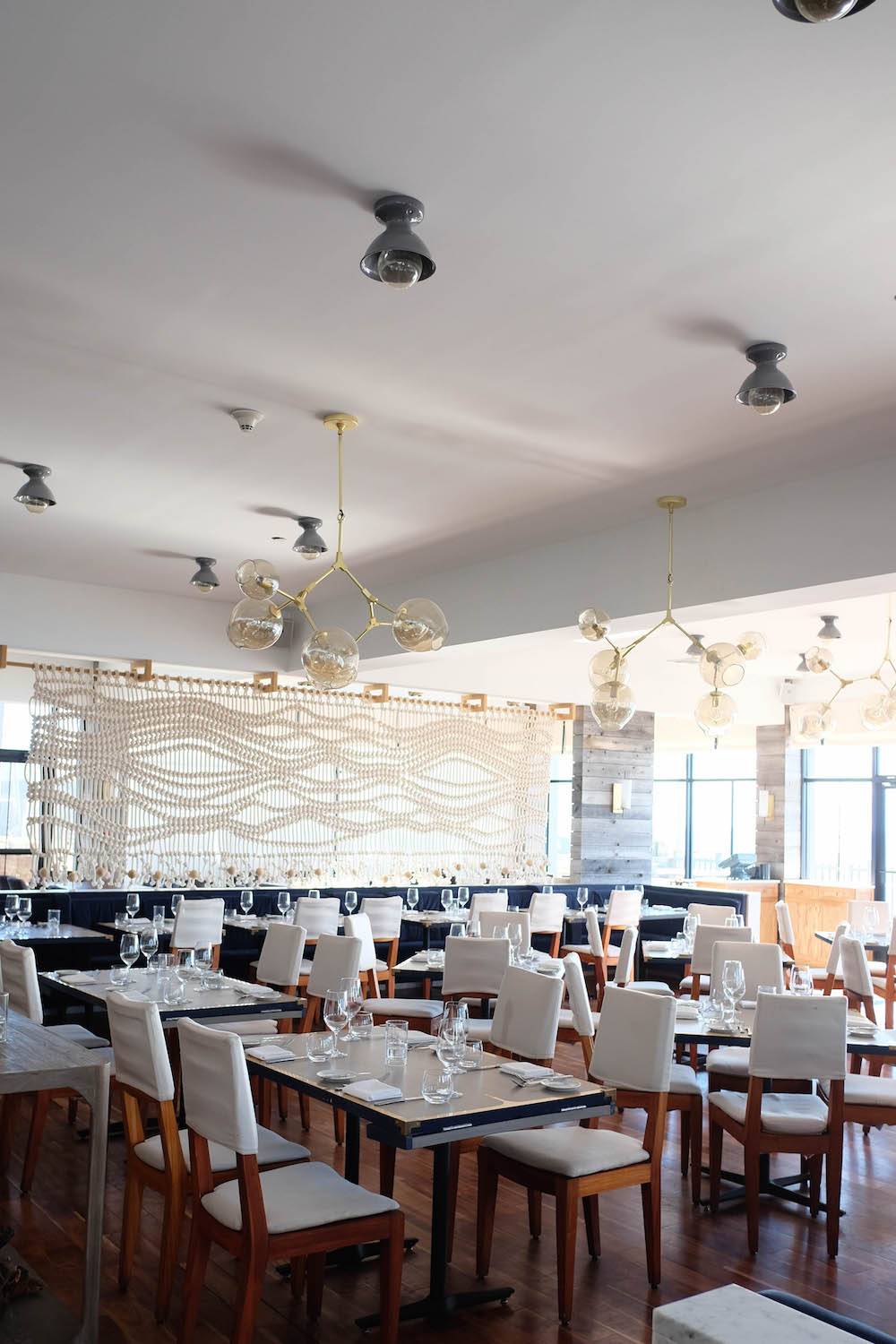 A Fall Weekend at Gurneys Beach Club. Scarpetta Beach Restaurant - Grace Atwood, The Stripe
