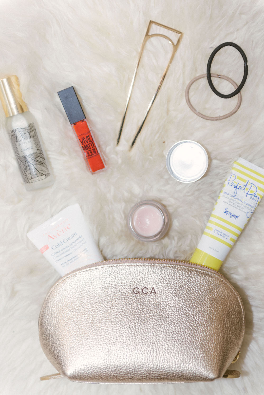 six must have beauty products that are always in my bag | Grace Atwood, The Stripe - Caudalie Beauty Elixir, Avene Cold Creme, Maybelline Vivid Matte Liquid, by Terry Baume de Rose, Oribe Hair Pin, Supergoop Perfect Day Sunscreen