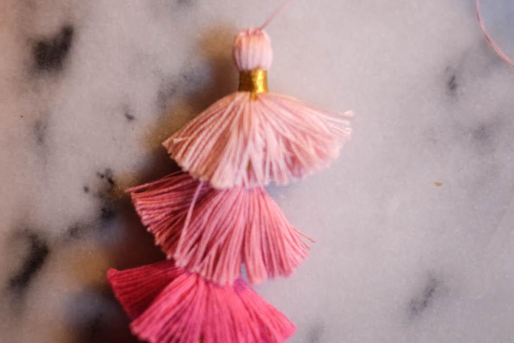diy tassel earrings // the stripe blog: easy tutorial to create layered multicolor tassel earrings.
