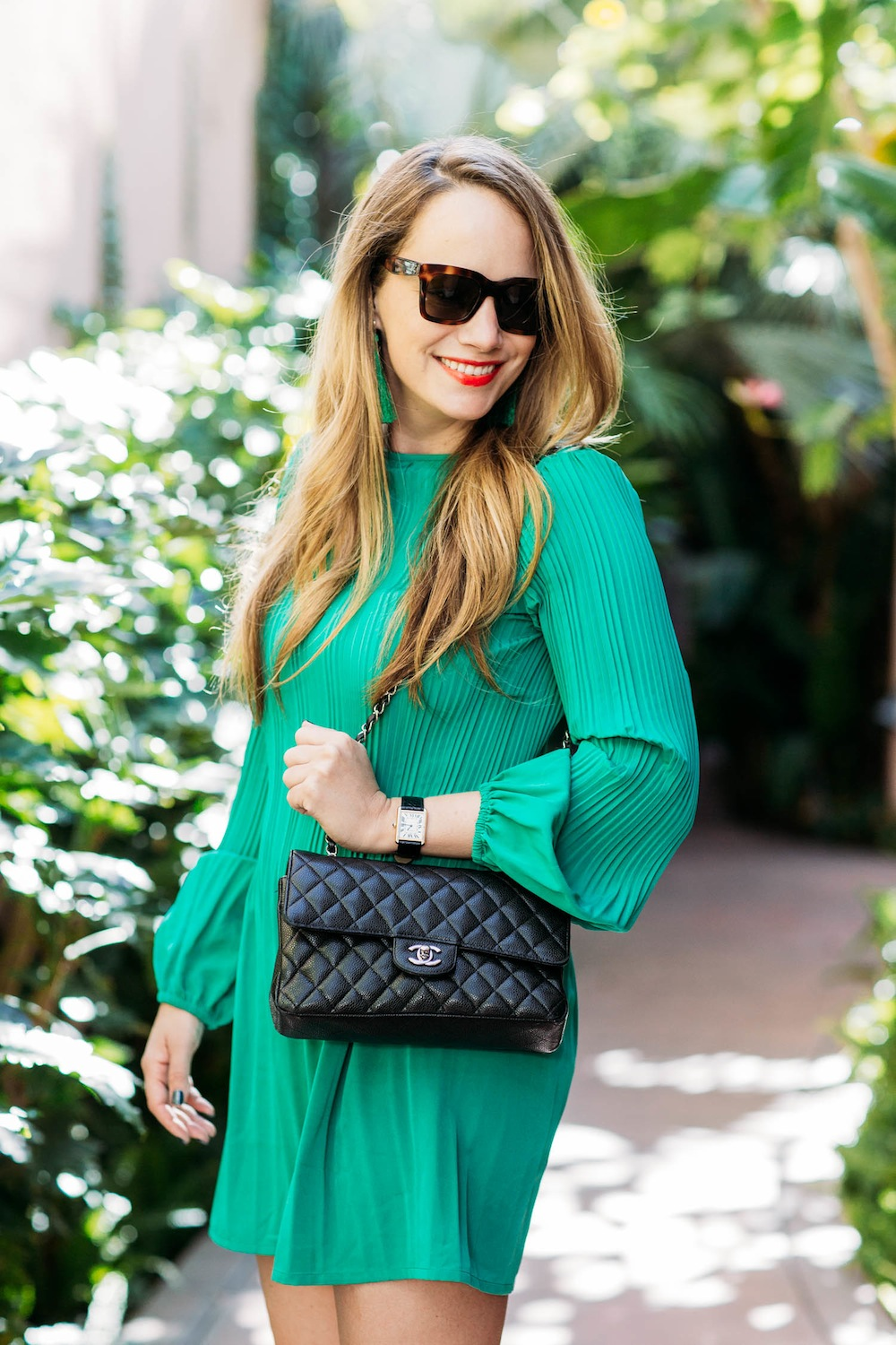 green dress and black chanel bag