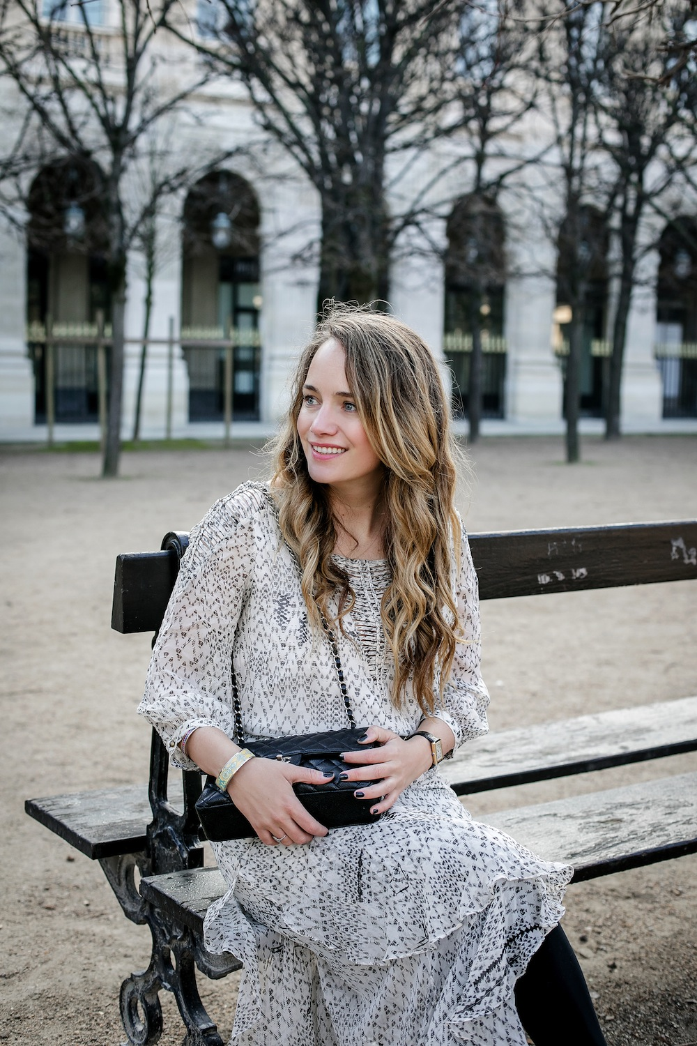 palais royal paris / grace atwood from the stripe wearing a cynthia vincent midi dress in paris.