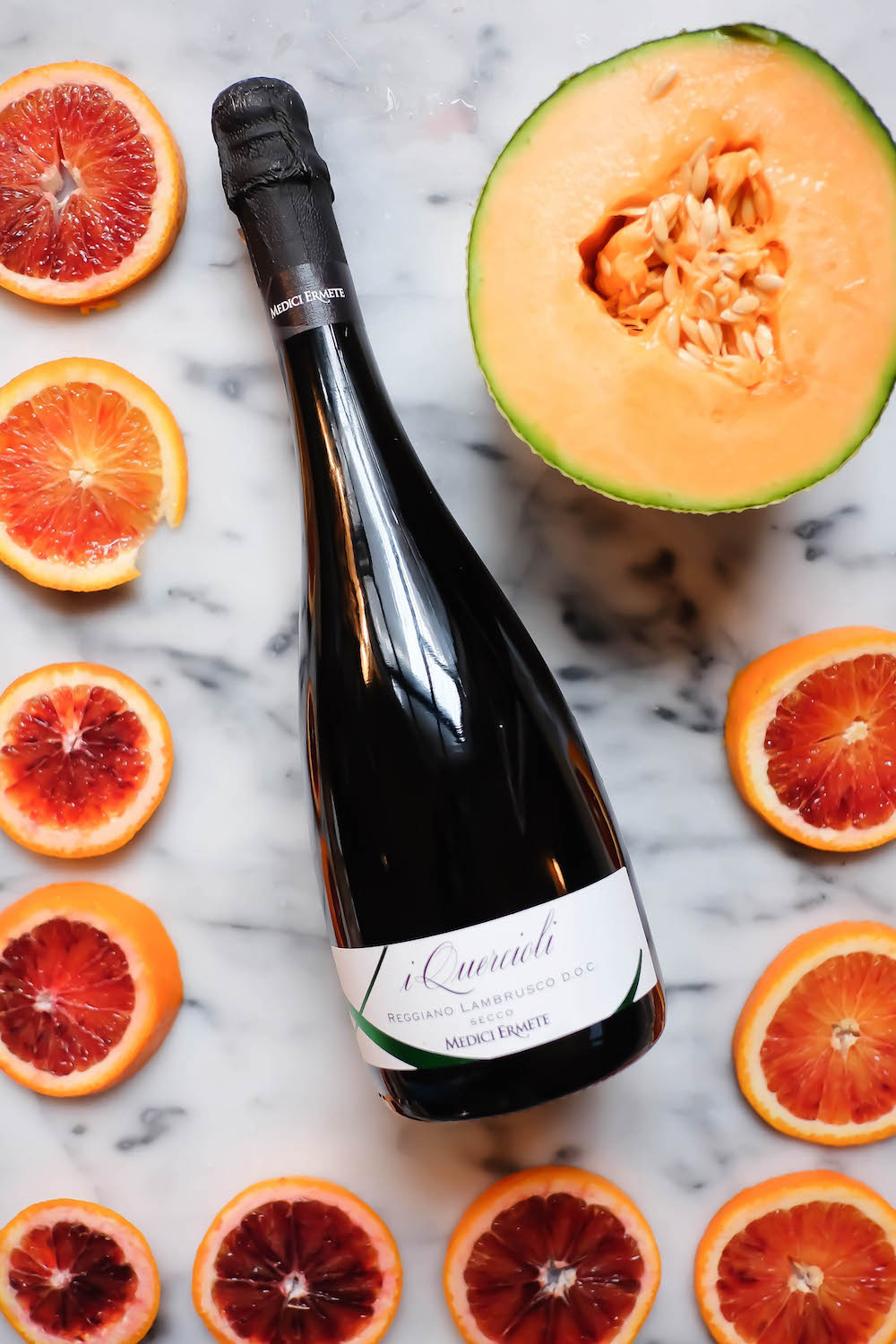 winter frosé recipe - ingredients: lambrusco wine, blood orange, cantaloupe | the stripe blog