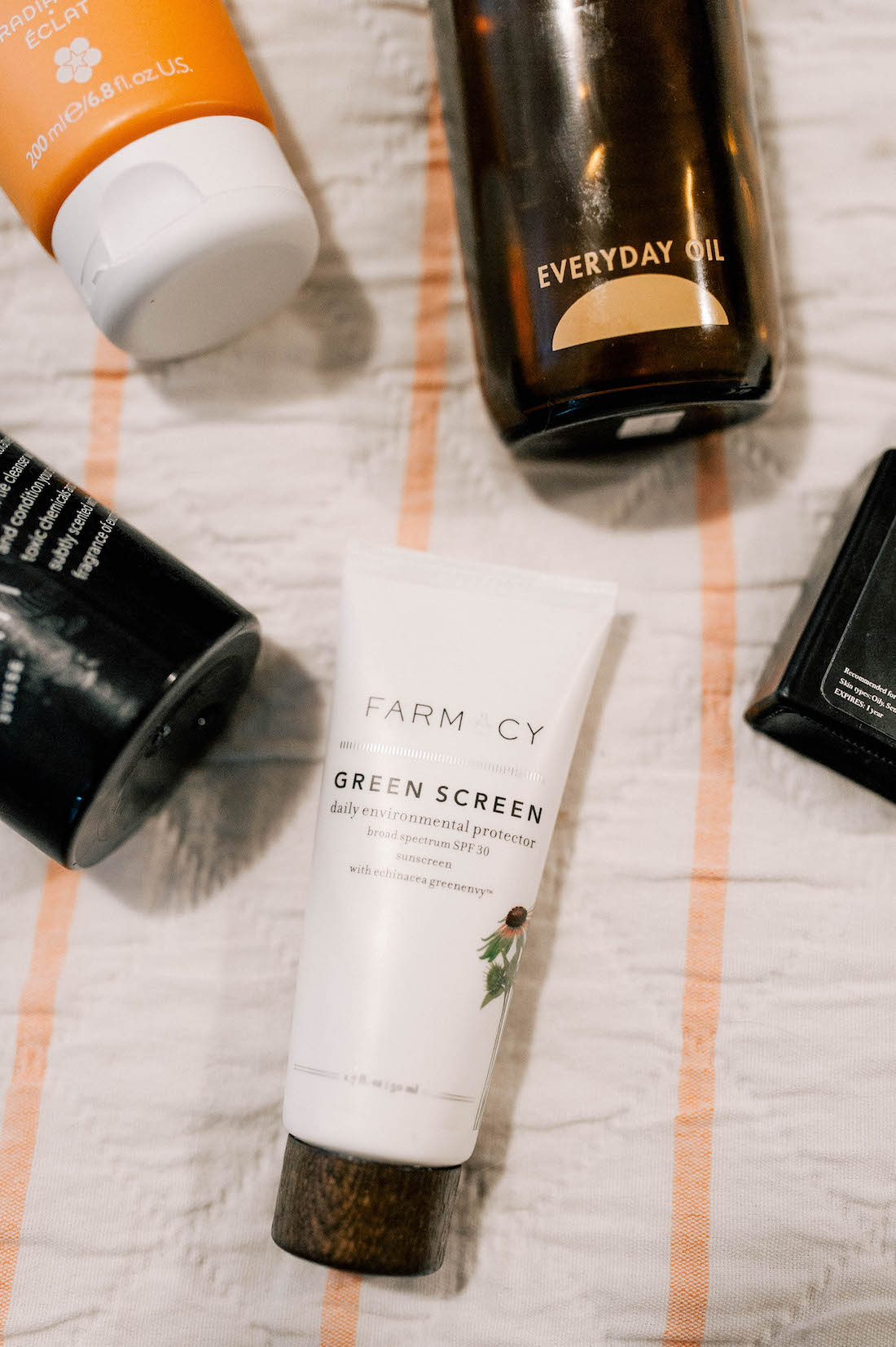 5 clean beauty products to know now: everyday oil, leo oil, farmacy green screen, abhati body wash, REN AHA body serum