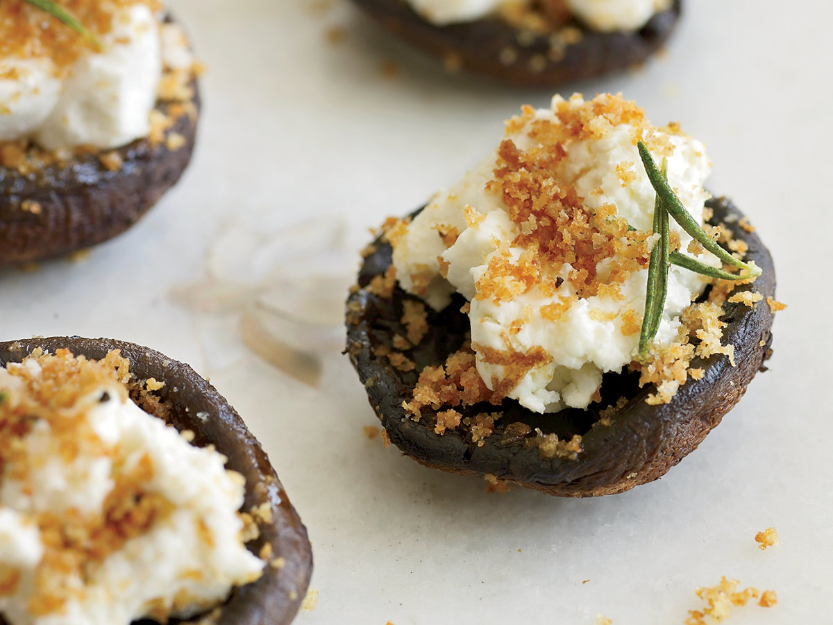 the ten best make ahead appetizers for all of your holiday gatherings | goat cheese stuffed mushrooms from food & wine magazine.