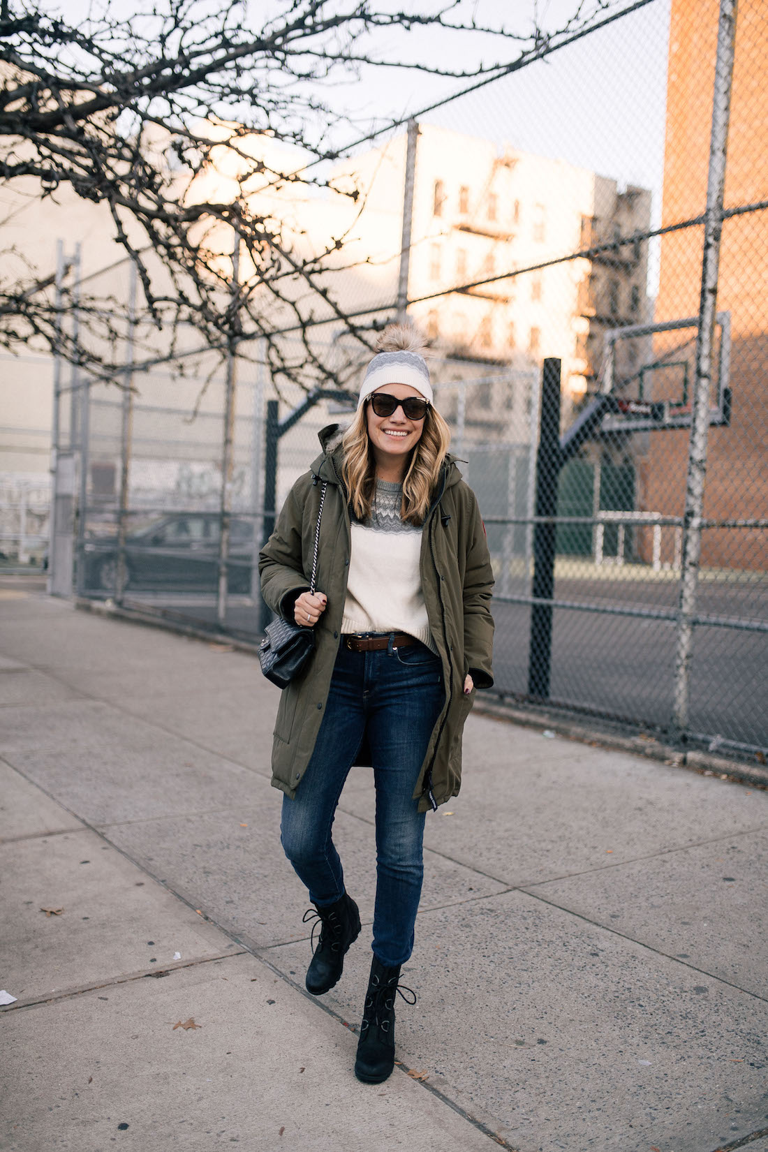 Outfit Details:Canada Goose Parka // Vineyard Vines Sweater + Hat (c/o) // Good American Jeans // Sorel Boots // Chanel Purse // Polaroid Sunglasses