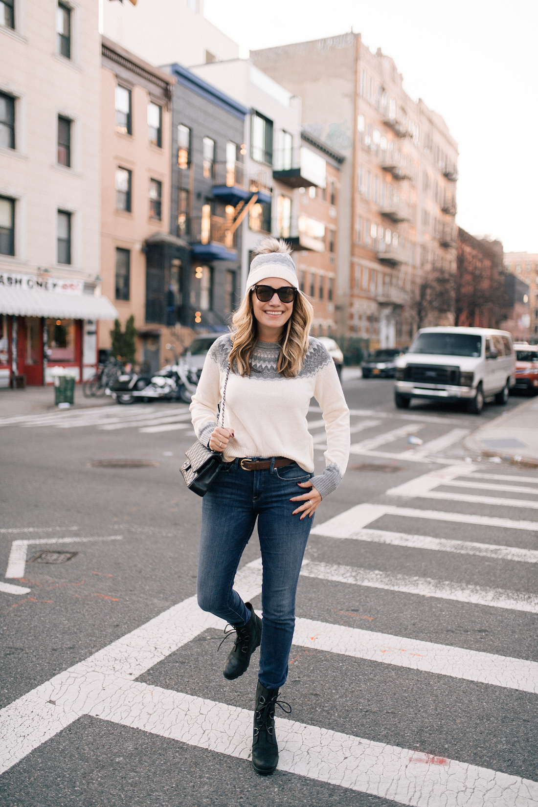 Outfit Details: Vineyard Vines Sweater + Hat (c/o) // Good American Jeans // Sorel Boots // Chanel Purse // Polaroid Sunglasses