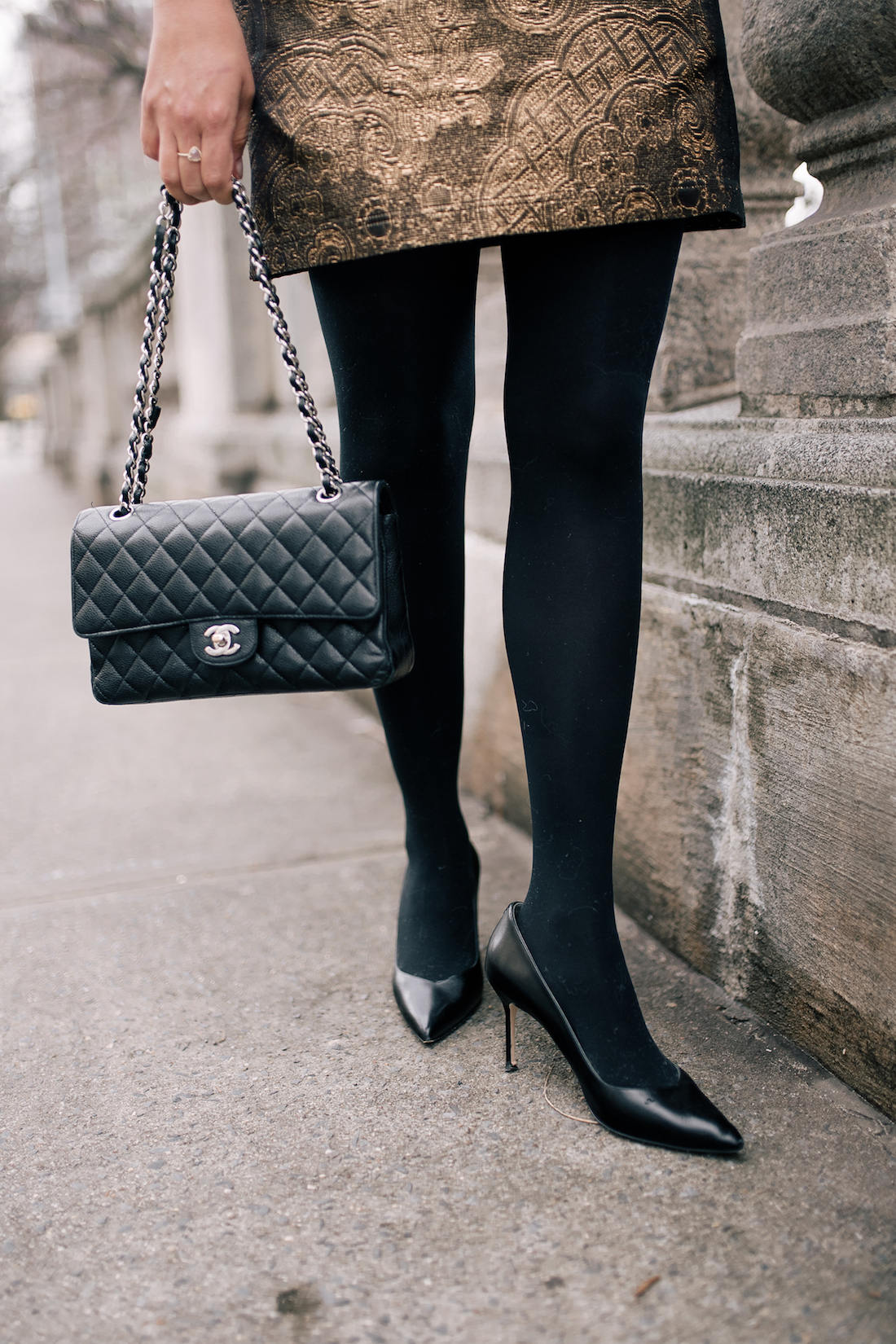 Chanel Bag and Black Pumps