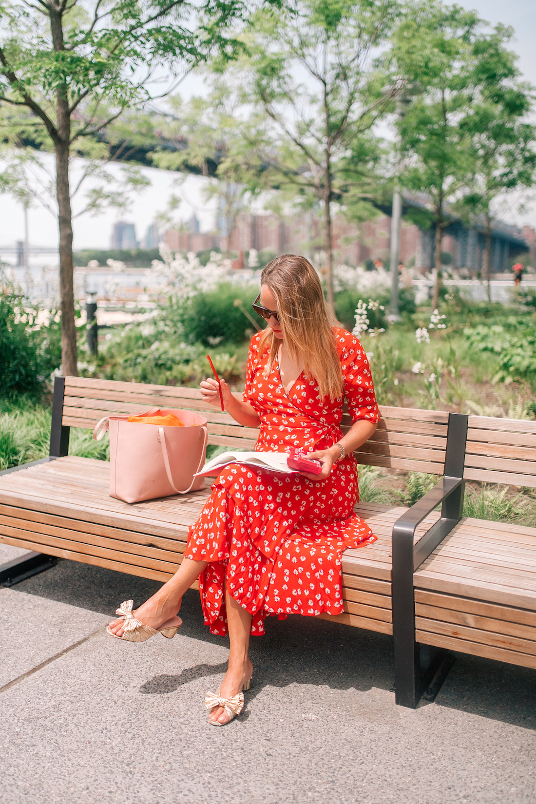 Grace Attwood is wearing a red floral dress