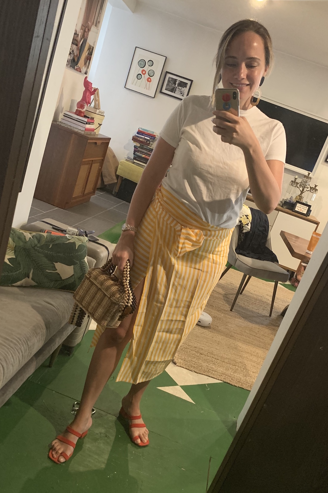 A yellow skirt paired with a white tee