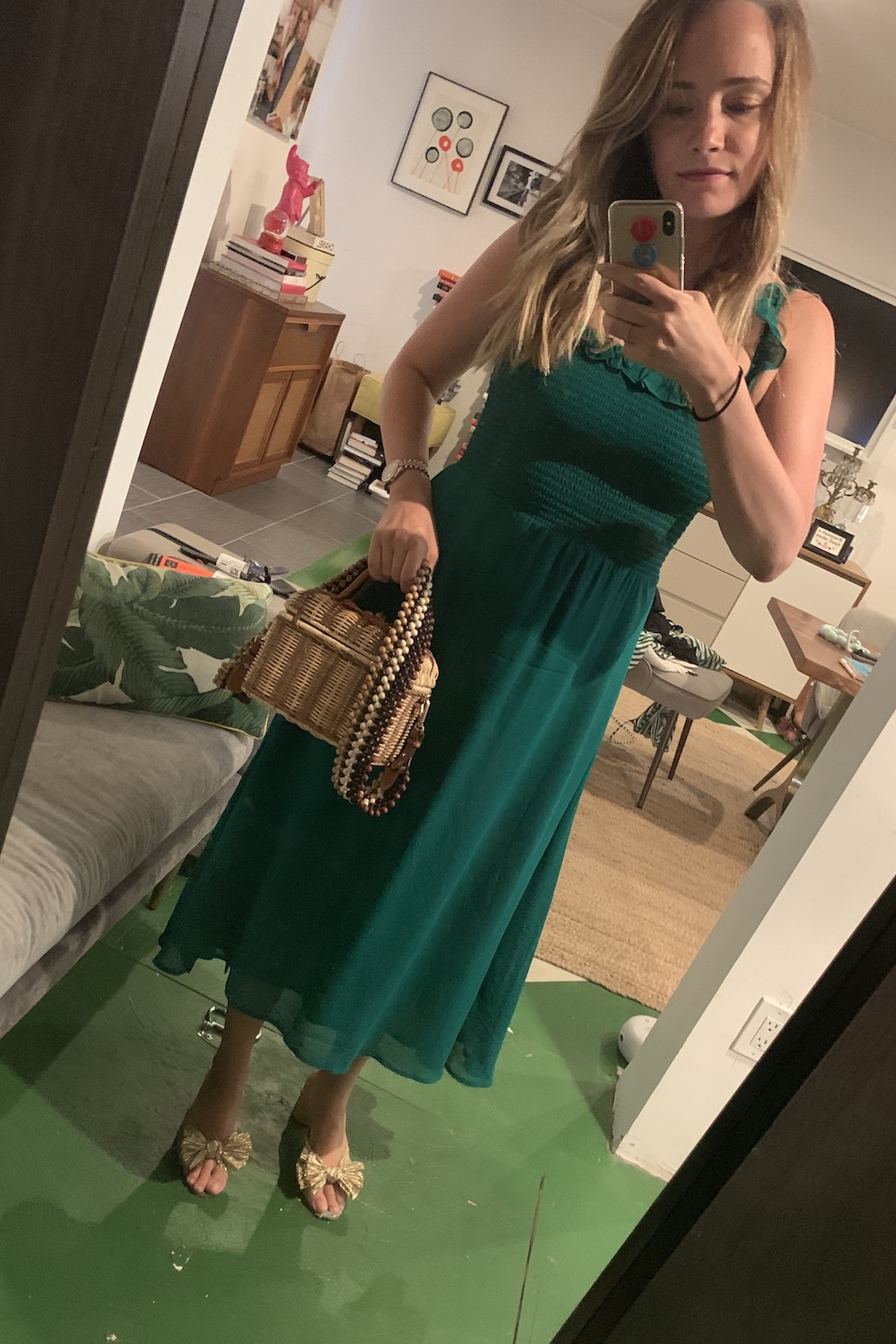 A green dress and structured bag