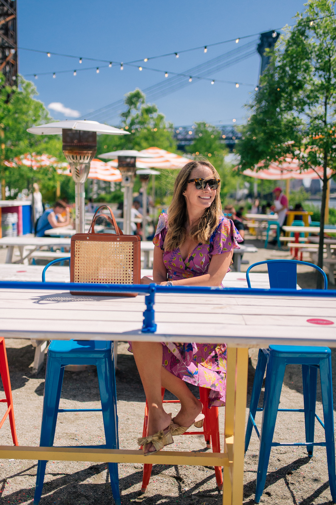 best outdoor bars in nyc and brooklyn include this great spot with colorful chairs