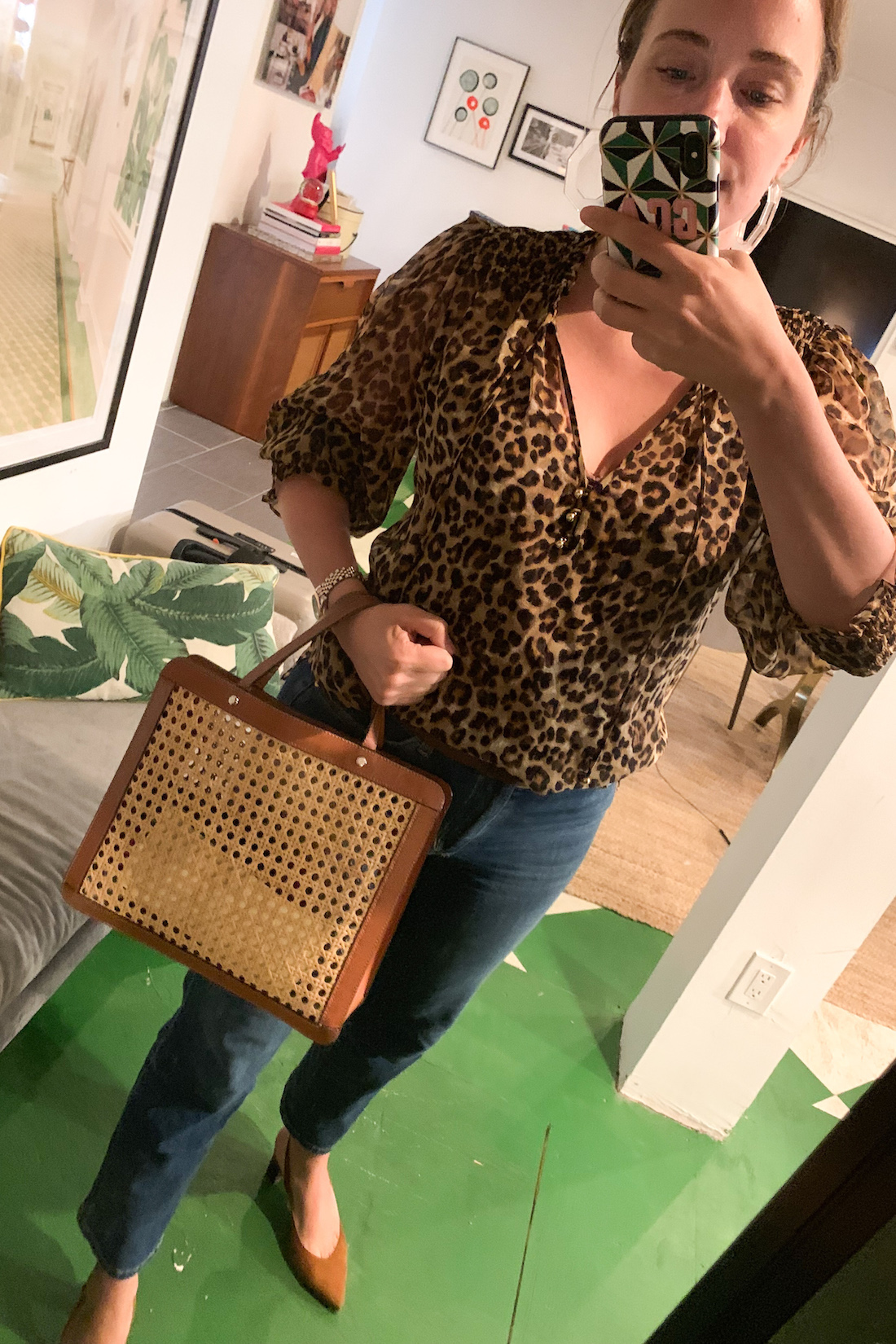 grace wearing jeans and a cheetah blouse
