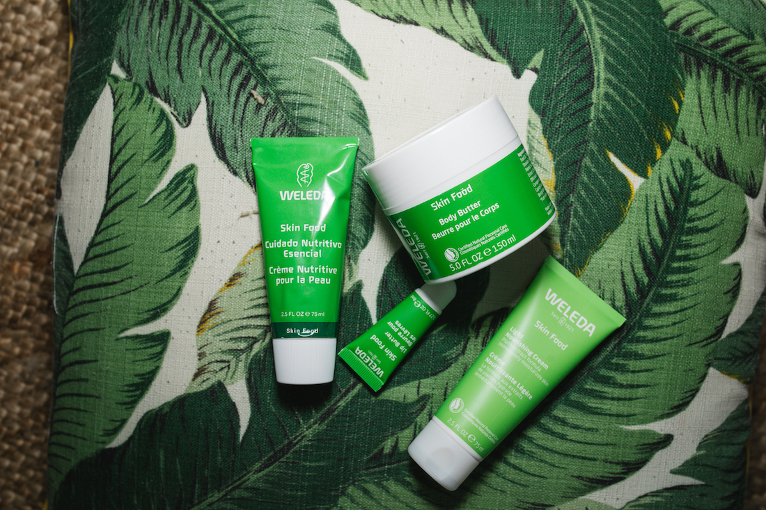 How to Use Weleda Skin Food with their products all out on a patterened background