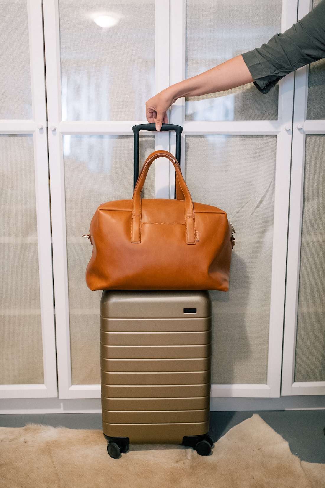 suitcase and leather bag