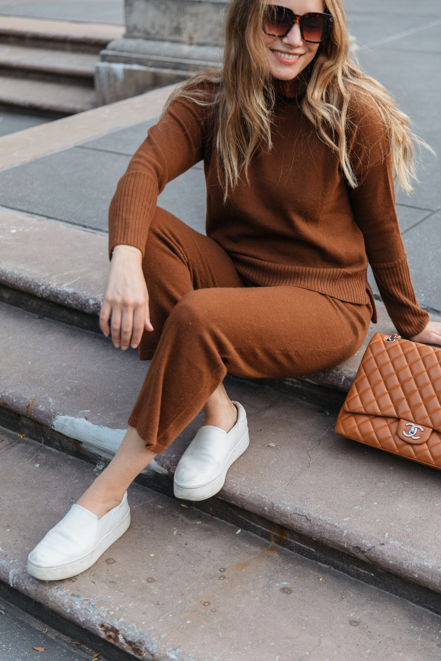 high-low turtleneck and cropped cashmere pants.